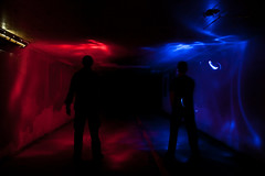 Dueling Hues (Chase Hoffman) Tags: longexposure blue light red summer people lightpainting man color men me silhouette night self canon underpass eos colorado silhouettes wideangle tunnel boulder symmetry erik hansen redblue bluered canonefs1022mmf3545usm lightpaint 40d chasehoffman canoneos40d bikepass helpfromeazyfoto chasehoffmanphotography