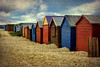 Beach Huts, West Wittering (sminky_pinky100 (In and Out)) Tags: uk england sky texture beach wooden sand westsussex painted coastal colourful beachhuts westwittering abigfave omot citrit eyejewel beachhutelite