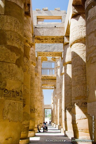 Tourist stream along the path through the pylons at the entrance of Karnak Temple, near Luxor, Egypt.