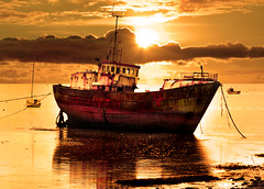 Sailing No More (DDA / Deljen Digital Art) Tags: old uk sunset sea england sky cloud sun seascape reflection nature photoshop boat ancient ship glow transport digitalart cumbria layers rusting yachts tied photographicart filters retired westcoast pleasure cumberland chained anchored moored calmwaters skychange seavessal