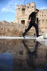 five feet of history (maybemaq) Tags: blue sky cloud man reflection castle history water walking jump walk citadel muslim ruin move symmetry step syria reflexions breathtaking aleppo waterreflection eyewashdesign colourartaward