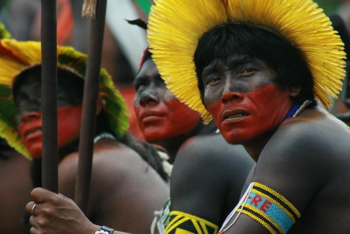Indigenous Amazonians pose for the cameras in helicopters above and on the ground, spelling out