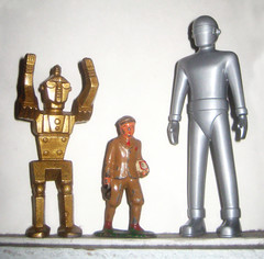 Two Robots and a Kid (Brechtbug) Tags: from school boy two men film metal by toys gold robot is kid still day earth space hard right plastic robots figure outer archer middle left lead solid barclay 1952 gort plastics stood the manoil
