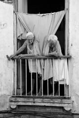 Two old sisters (Maron) Tags: old woman window sisters women looking grandmother balcony curtain havana cuba curious leaning havanna grandmothers lahabana nikond80 flickraward supermarion bildekritikk marionnesje nikonflickraward