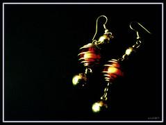 Jumka gira re... [Explored #363] (D a r s h i) Tags: orange golden earring balls accessories jewelery hangings darshi jumka darshita