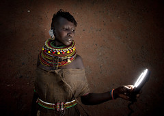 Turkana girl and the ring flash - Kenya (Eric Lafforgue) Tags: africa light portrait people woman cute girl face nice kenya flash culture tribal human tribes afrika tradition tribe ethnic tribo gens ringflash visage afrique ethnology tribu eastafrica turkana qunia 7172 lafforgue trbal ethnie  qunia    kea   humainpersonne a
