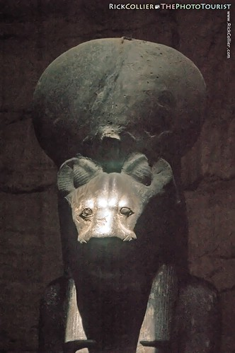 A black statue of Egyptian goddess Sekhmet is illuminated by a ray of sunlight in the Shrine of Ptah at Karnak Temple, near Luxor, Egypt.