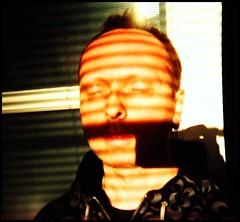 Swallowing Flames of Light (robinrimbaud) Tags: shadow portrait face lomo closed scanner robinrimbaud noritsukokiqss3233 lomolitodisposable imageourtime