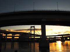 Train in the morning light (nadonado) Tags: road bridge water japan train tokyo morninglight expressway seashore shibaura loopbridge urikamome