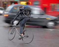 Busy intersection (jeremyhughes) Tags: city motion blur bus london bike bicycle movement nikon zoom taxi singlespeed fixed intersection fixie fixedgear messenger d200 nikkor courier omnibus cityoflondon bikemessenger redbus squaremile nikond200 fixedwheel bikecourier slowshutterspee