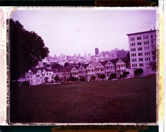 Purple Painted Ladies (roostercoupon) Tags: sf california ca camera ladies house color film architecture analog vintage square frames san francisco downtown 2000 purple painted postcard horizon victorian vivid shift location row tourist land pro instant historical expired alamo 340 689