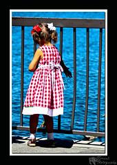 feeding the ducks (JJennFro) Tags: food lake water girl canon outside eos rebel child ducks bow feed xs pigtails lakearrowhead 1000d