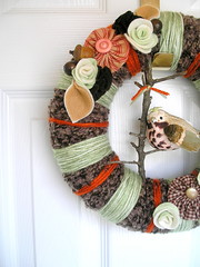 Pumpkin Patch Yarn Wreath (KnockKnocking) Tags: door autumn roses orange woman brown tree green bird art fall home girl hat rose wall altered pumpkin cozy 3d warm soft sweet handmade assemblage mixedmedia feminine unique decoration harvest wrapped felt yarn wreath fabric figure button hanging aviary fiber decor yoyo embellished fibre vintagebutton greenrose chocolatebrown yarnwreath barkbird