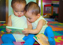 They read a LOT. Read, read, read. (sweetkendi) Tags: smart reading twins toddler babies adorable read cuties playingroom