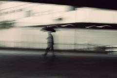 Fleeting man (Che-burashka) Tags: street motion london silhouette umbrella blurry gettys 400d blurpeople gettyskn
