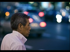 The weight of life (Fabio Sabatini) Tags: japan lights tokyo blog shinjuku dof traffic bokeh depthoffield  f2 boke salarymen    sararman shinjukuku canon100mm