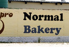 Normal Bakery (cowyeow) Tags: poverty africa street old silly bread weird town crazy funny sad market african empty wrong bakery badsign rough taliban decrepit namibia selling funnysign dilapidated brothel rundown buying namibian uglybuilding funnyname ruacanafalls ruacana crapsign funnyafrica