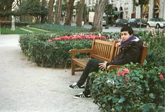 Why would he come back through the park? (RL Stars) Tags: park flowers parque winter boy portrait flores film bench retrato banco chico alameda photoart vigo analgico 9702 kniger rlstars