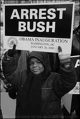"""Arrest Bush"" (The Voice of Eye) Tags: boy people usa history sign outdoors photography democracy dc washington neworleans political politics culture documentary communication identity single portraiture signage editorial africanamerican historical humanrights enthusiastic activist symbolic streettheater symbolism greyscale sociology humaninterest hopeful participation barackobama culturaldevelopment liberated actuality specialreport lifeasart environmentalportraiture noapologies craigmorse culturesubculture washingtondcdistrictofcolumbia ascendent blackandwhiteblackandwhitebw blancoynegroblancoynegro thevoiceofeye neroebianconeroebianco noiretblancnoiretblanc pretoebrancopretoebranco schwarzesundweischwarzesundwei zwarteenwitzwarteenwit customsandtradition presidentialinauguration2009"