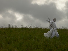 Overcast & divine (happeningfish) Tags: statue angel self performance johanna salo germination sitespecific taide enkeli hiidentie itminen johannamacdonald