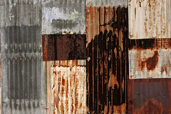 Wall of Rust and Crust, Tucson (cobalt123) Tags: arizona texture metal wall composition crust mixed rust tucson panels patches corrugated corrugatedmetal patched abstractthinking realityabstract nearconventioncenter wsimpsonstreet showingonesmettle