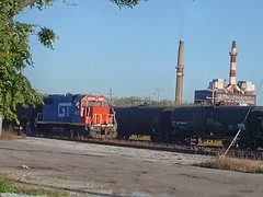 A former GTW locomotive at work spotting tank cars. Crawford Yard. Chicago Illinois. Early October 2007.