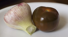 young garlic and a 'black' greenhouse tomato