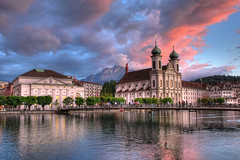 Lucerne's Jesuit Church, Switzerland (**Anik Messier**) Tags: bridge sunset mountain mountains church horizontal clouds landscape switzerland catholic suisse religion towers luzern rivire explore pilatus pont baroque nuages lucerne jesuitenkirche frontpage glise soe hdr touristattraction montagnes concerthall swissalps jesuits reuss gutsch jesuitchurch riverreuss baroquechurch mywinners abigfave shieldofexcellence pilatusmountain citrit lucernesjesuitchurch