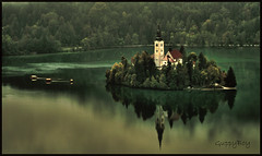 Lake Bled (GuppyBoy) Tags: trees lake reflection water canon island eos slovenia bled hdr curch lakebled pletna 400d jankoroec