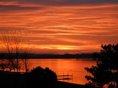 Sunrise November 17, 2001 (Ruthie Kansas) Tags: red sky sun lake clouds sunrise backyard view searchthebest loveit sensational naturesfinest blueribbonwinner thegoldengallery supershot addictedtoflickr mywinners worldbest platinumphoto anawesomeshot isawyoufirst citrit goldstaraward skyascanvas