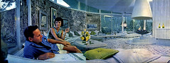 House of Tomorrow -  panorama of interior (ouno design) Tags: white stone wall architecture carpet design mod 60s fireplace couple interior palmsprings modernism 1950s stonewall 50s 1960s decor shag groovy interiordesign modernist shagadelic desertmodern palmerkrisel