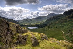 England: Cumbria - Blea Tarn from Lingmoor Fell (Tim Blessed) Tags: uk sky mountains nature clouds landscapes countryside scenery lakes cumbria ponds lakedistrictnationalpark tarns singlerawtonemapped