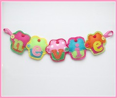 NEW cupcake name banner 'Nevie' by Heartfelt Handmade (heartfelthandmade) Tags: red orange yellow bright handmade turquoise name banner felt garland fuschia cupcake spotty lime fruity pompom nevie