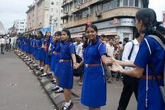 human barriers (kapil_b) Tags: ganesha uniform mumbai schoolgirls ganeshchaturthi ganeshvisarjan ganpatibappa ganesha2009