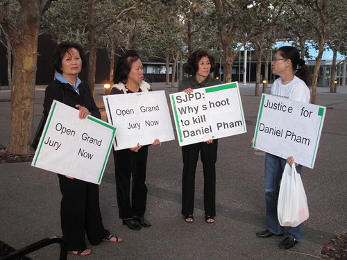 Vietnamese-American marchers came to the county building to seek a grand jury investigation into the death of Daniel Pham.