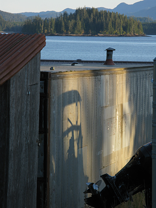 a boat casts a shadow in midtown Kasaan, Alaska