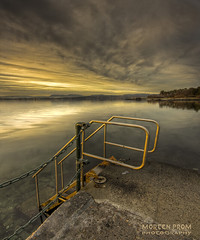 See you soon (mortenprom) Tags: ocean park longexposure winter light sunset sea sky orange brown sun white mountain black color reflection tree beach nature water yellow oslo norway metal stone clouds stairs forest fence landscape concrete island grey golden norge sand rocks december day cloudy pavement tripod skandinavien steps norwegen wideangle chain explore shore noruega scandinavia peninsula 2008 hdr oslofjord bygdy habour huk noorwegen noreg wideangel sigma1020mm skandinavia idream canoneos40d mortenprom mortenrovik
