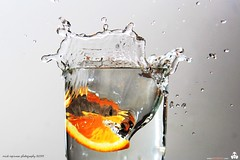 orange drops (erickespinosa) Tags: red orange white water photography drops chili flash cellphone bubbles splash spill highspeed fastshutter