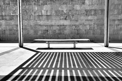 Empty bench in b&w, Valencia (MJ Reilly) Tags: shadow blackandwhite bw sun valencia lines wall bench spain nikon noir seat negro banco sombra ombre espana hero winner unusual d90 lalmoina friendlychallenges herowinner lalmoinacentrearqueologic nikond90bw