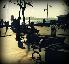 urban tales I -Istanbul (Eni Turkeshi Imagery) Tags: street city light shadow people urban sun color tree texture birds silhouette backlight turkey bench square bravo warm pavement candid grunge citylife lifestyle atmosphere istanbul expressionist conversation cinematic emotions vignetting tones iskele fugees tale avantgarde palabra beikta thecontinuum marielito fivestarsgallery fotografkiraathanesi visiongroup fotografeshqiptare independentphotos trashbit fotografca dostr fshstreet