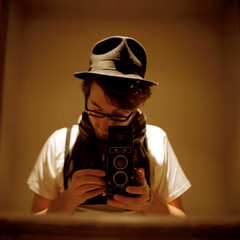 Seagull 0107 - Self-Portrait With Hat And Braces (ukaaa) Tags: selfportrait reflection 120 6x6 tlr film home me hat analog scarf myself square mirror braces kodak charlie negative medium mf analogue uka portra canoscan twinlensreflex portra160vc 8800f haiou seagull4a103 ukaaa