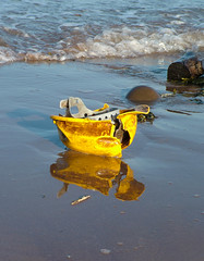 Hard hat washed up on Minehead beach (franieK) Tags: uk england reflection beach water hat yellow britain helmet hard somerset minehead westsomerset fujis7000