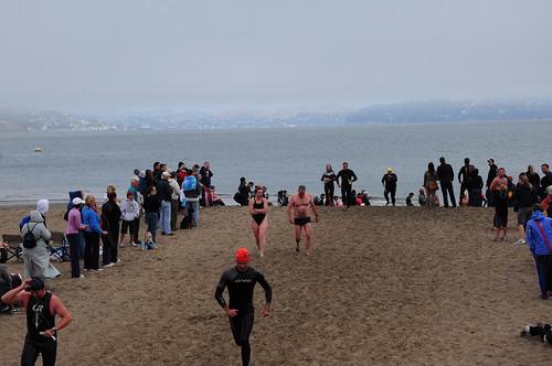 After the swim, competitors ran the gauntlet up the beach. Here are some of the front runners.