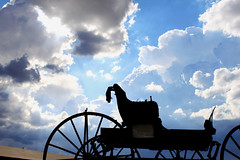 Wagon Clouds (See El Photo) Tags: california road ca travel trees sky 15fav tree nature beautiful silhouette clouds wagon outside outdoors wooden coach carriage ride cloudy country great wheels western oldtime 1f ouside faved greatphoto goingwest seeelphoto chrislaskaris