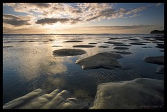 Mini Sand Lands (Mark Emirali) Tags: ocean light sunset sea newzealand sky cloud sun seascape colour reflection beach nature water clouds canon landscape sand auckland nz westcoast frontpage 1022mm piha 30d copyrighted canon30d explore1 sandislands nothdr pleasedonotusewithoutmypermission sandform maloe4 sandfingers maloephoto maloephotography markemirali
