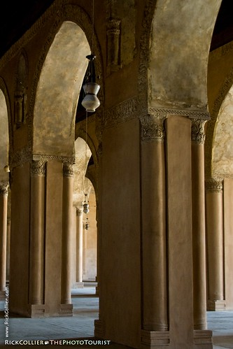 Lamps hang in the arches of the prayer arcades at ibn Tulun mosque in Cairo, Egypt.