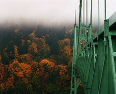The St. Johns Bridge enjoying Fall (Zeb Andrews) Tags: city bridge autumn urban usa fall architecture oregon portland fallcolors foggy stjohns backdrop pdx suspensionbridge stjohnsbridge bluemooncamera historicbridges zebandrewsphotography