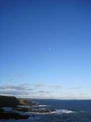 The Moon hanging over the cliffs
