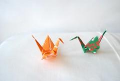 Two Origami cranes, in green and orange (Otomodachi) Tags: orange cute green bird birds paper origami groen vogels kawaii papier folding vogel lief oranje vouwen schattig