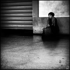 just waiting... (:n:) Tags: city bw woman blur paris france station train blackwhite blurry waiting sitting dof saintlazare noiretblanc olympus 50mm14 nb silence frame om zuiko e510 75009